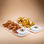 Vinegar chips and plantain chips with caramelized onion dip