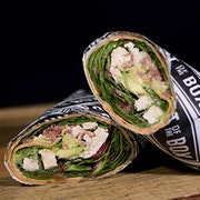 Fire roasted chicken breast, bacon, avocado, tomato, mixed greens and creamy buttermilk ranch in a tomato basil wrap.