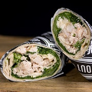 Fire roasted chicken breast, chopped romaine, shaved asiago-parmesan-romano cheese blend and creamy caesar dressing in a garlic herb wrap.