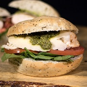 Fire roasted chicken breast, Swiss cheese, tomato, spinach and nut-free pesto on a focaccia roll.