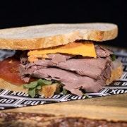 Roast beef, cheddar cheese, tomato, arugula and chipotle aioli on artisan sourdough bread.