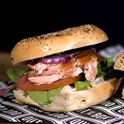 Honey smoked salmon, red onion, tomato, mixed greens and boursin garlic herb cheese on an everything bagel.