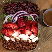 Fresh strawberries, dried cranberries, candied pecans, queso fresco and red onion on a bed of spinach. Served with balsamic dressing.