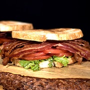 Eight strips of crisp hickory smoked bacon, lettuce, tomato and mayonnaise on toasted artisan sourdough.