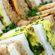 A mixture of sandwiches which serve up to 5 people including BLT; Coronation Chicken with Spinach; Tuna Mayo & Red Onion; Egg Mayo & Spinach; Cheddar Ploughman