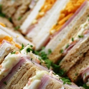 A mixture of sandwiches which serve up to 3 people including Pastrami, Brie & Basil; Turkey, Ham & Coleslaw; Roast Beef & Horseradish