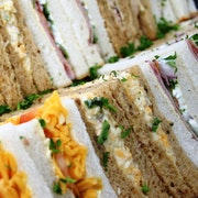 A mixture of sandwiches which serve up to 5 people including Ham Salad; Cheese & Tomato; Savoury Cheese; Tuna Mayo & Red Onion; Roast Beef & Horseradish