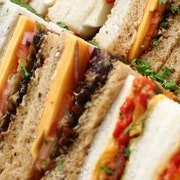 A mixture of sandwiches which serve up to 3 people including Cheddar Ploughman