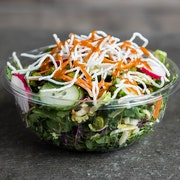 Power greens, arugula, sunflower sprouts, carrots, mint, rice noodles, radishes, cucumbers and roasted edamame. Tossed with cilantro lime dressing and finished with a peanut sauce drizzle  RECOMMENDED WITH BLACKENED SHRIMP