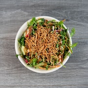 a refreshingly crisp and tangy combination power greens, arugula, sunflower sprouts, mint, carrot, radish, cucumber, roasted edamame, crispy rice noodles, cilantro lime dressing, peanut sauce drizzle  ADD SEASONED SHRIMP OR CHICKEN BREAST