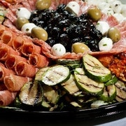 Cured Italian meats, cheeses, marinated vegetables and Kalamata olives, accompanied by our petite bread slices