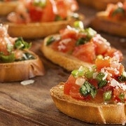 Crostini topped with Roma tomatoes, fresh garlic and sweet basil