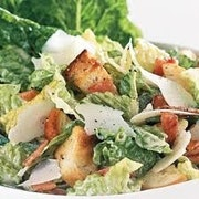 Hearts of Romaine, toasted croutons, shaved Parmigiano Reggiano and tossed with Caesar dressing