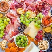 Local Artisan cheeses paired with seasonal fruits and a variety of nuts. Served with an assortment of breads and crackers
